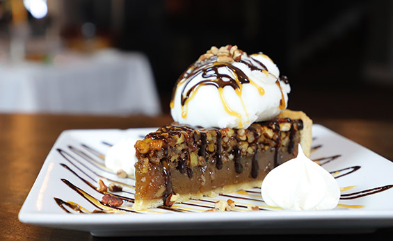 Slice of pie with nuts and whipped cream