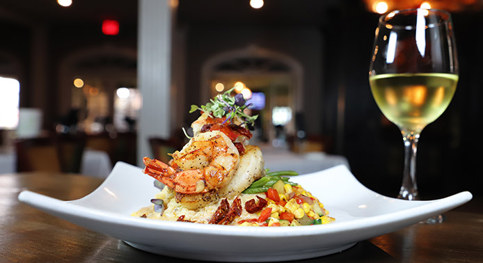 fancy dish with shrimp and wine